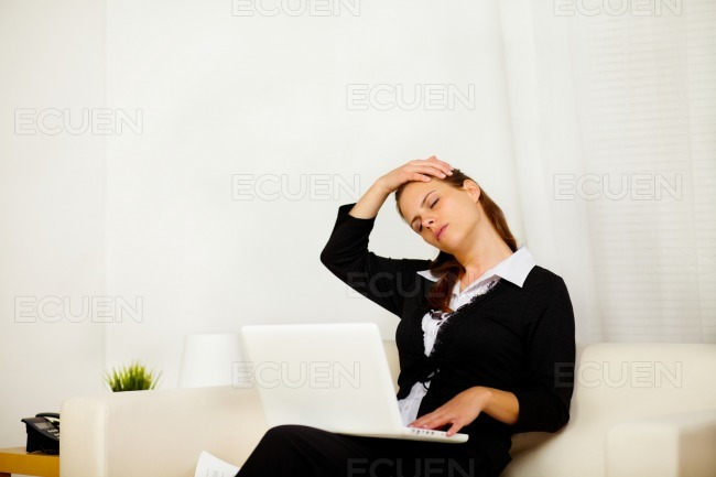 Business woman at home with neck pain stock photo