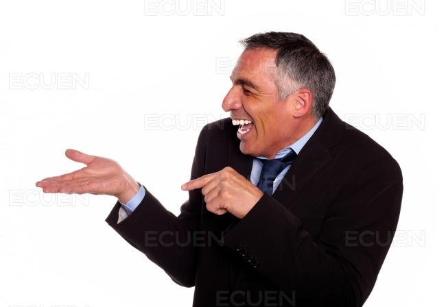 Businessman laughing and pointing extended hand stock photo