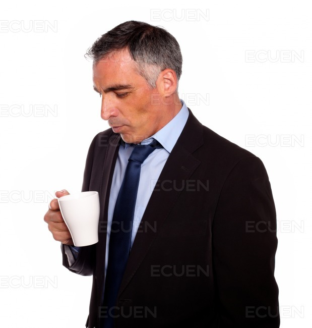 Businessman looking to a empty mug stock photo