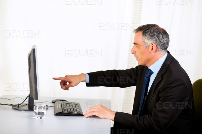 Businessman pointing the computer stock photo