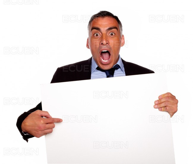 Businessman screaming and pointing a card stock photo