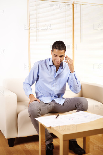 Businessman talking on mobile phone stock photo
