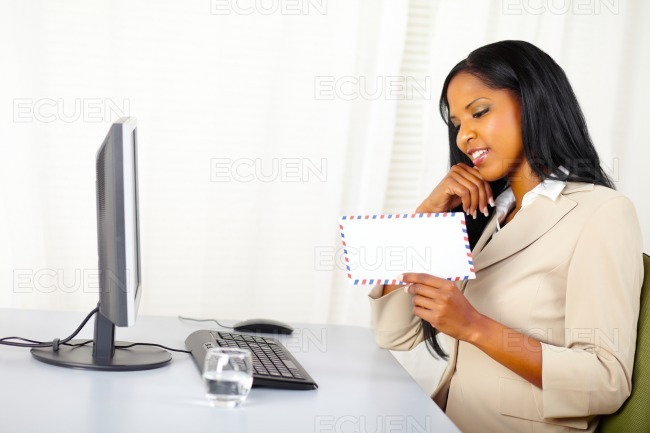 Businesswoman looking to a letter stock photo