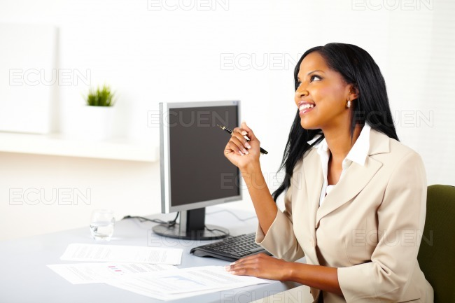 Businesswoman on work looking up stock photo