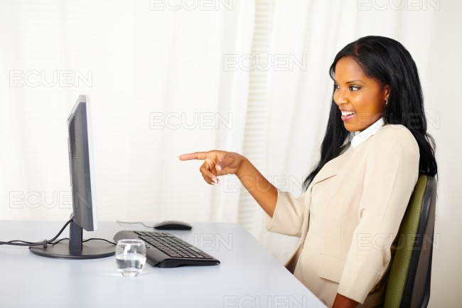 Businesswoman pointing the computer screen stock photo