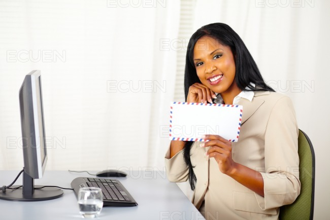 Businesswoman showing a letter stock photo