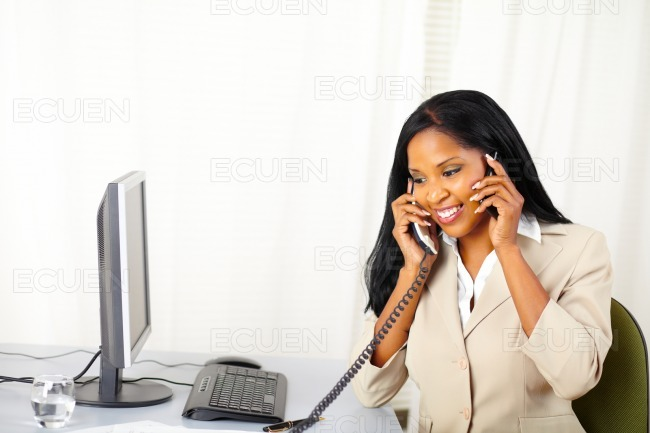 Businesswoman speaking with two persons stock photo