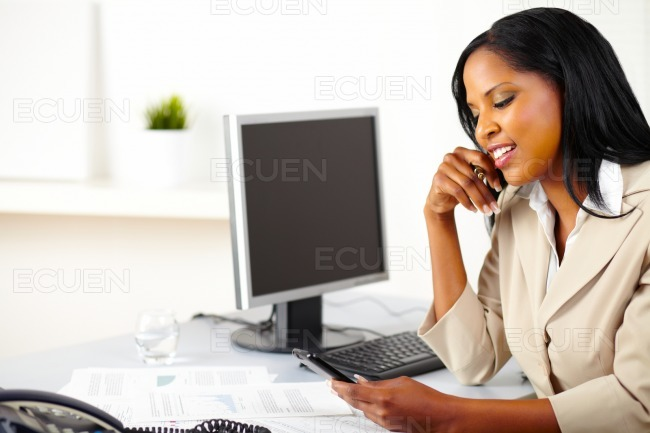 Businesswoman using a mobile phone stock photo