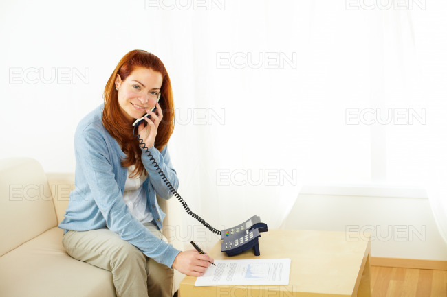 Businesswoman working and talking at phone stock photo