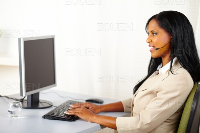 Callcenter operator working on computer stock photo