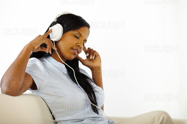 Calm young woman listening to music stock photo