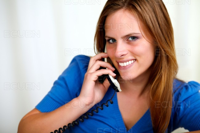 Caucasian blonde young woman smiling on phone stock photo