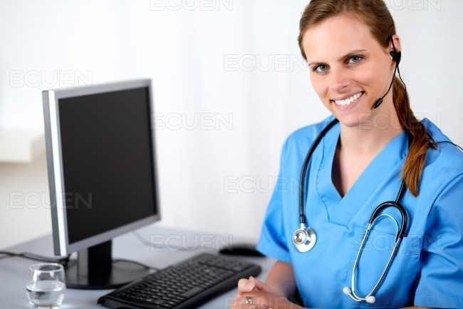 Caucasian medical secretary smiling stock photo