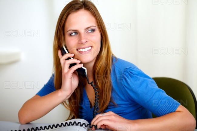 Caucasian smiling blonde woman on phone stock photo