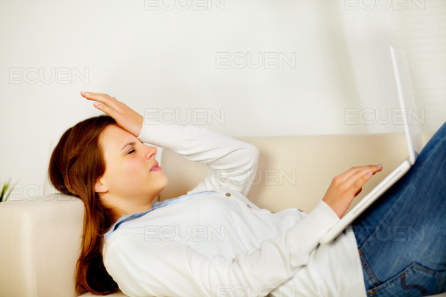 Caucasian woman working on laptop stock photo