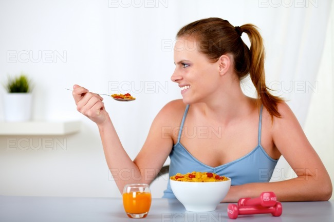 Caucasian young woman smiling and eating stock photo