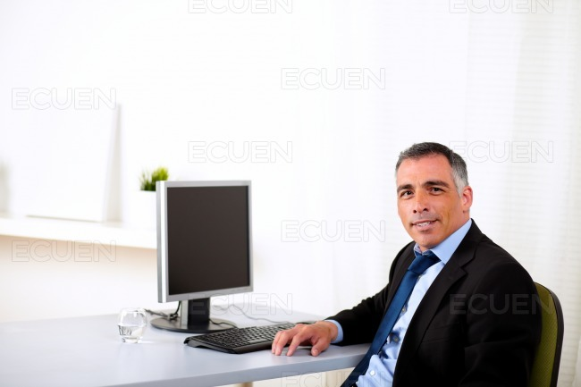 Charismatic executive working at the office stock photo