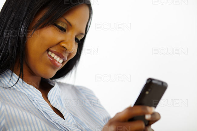 Charming beautiful young woman using a mobile stock photo