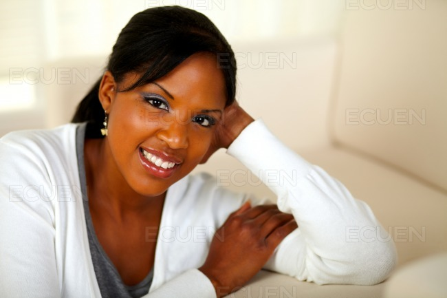 Charming black female looking and smiling at you stock photo