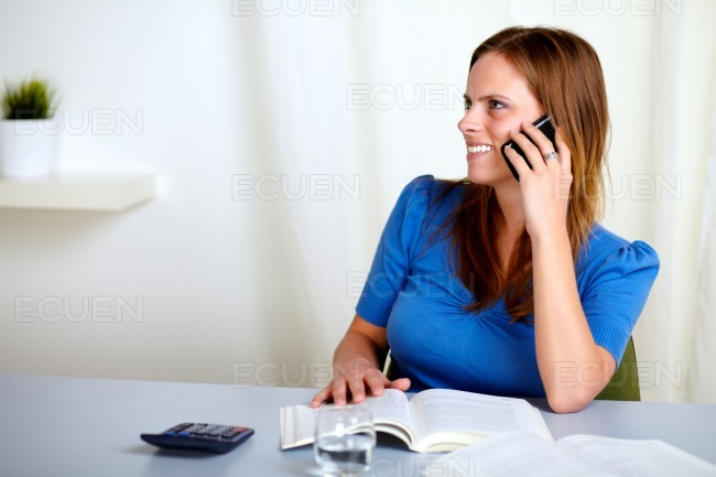 Charming blonde lady talking on mobile phone stock photo