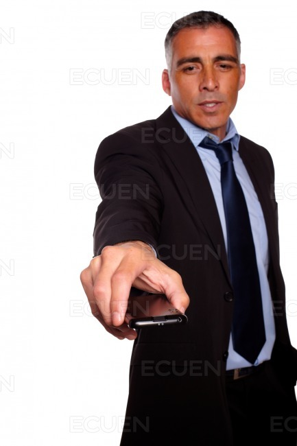 Charming business man offering a mobile phone stock photo