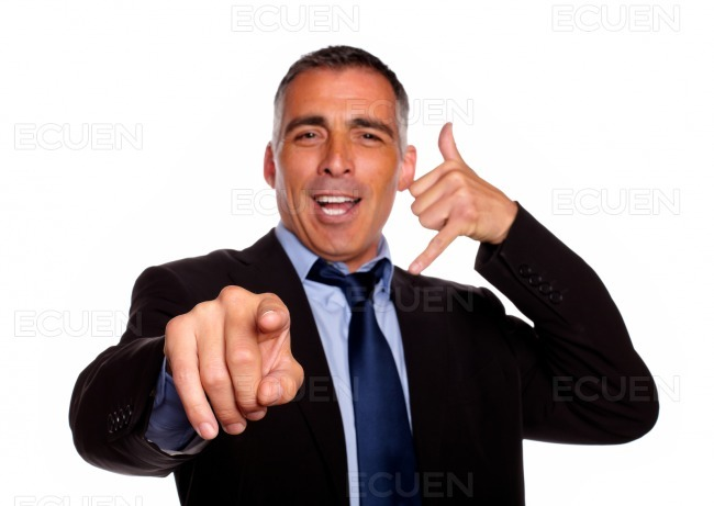 Charming business man pointing stock photo