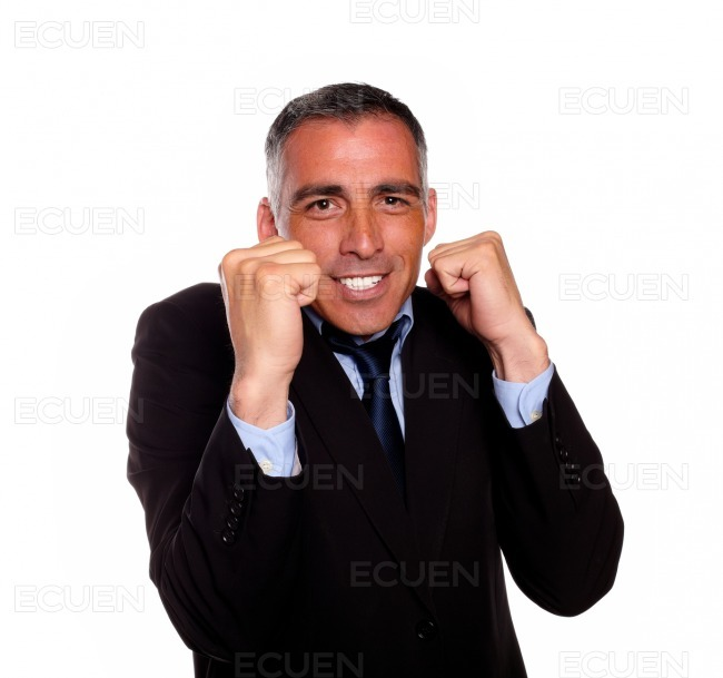 Charming latin businessman boxing stock photo