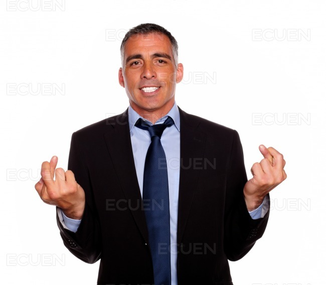 Charming latin businessman crossing the fingers stock photo