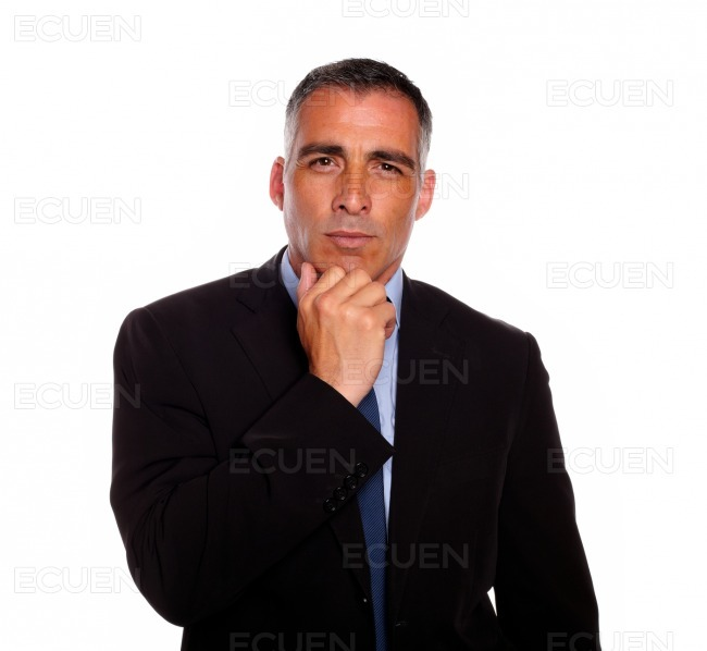 Charming latin businessman thinking stock photo