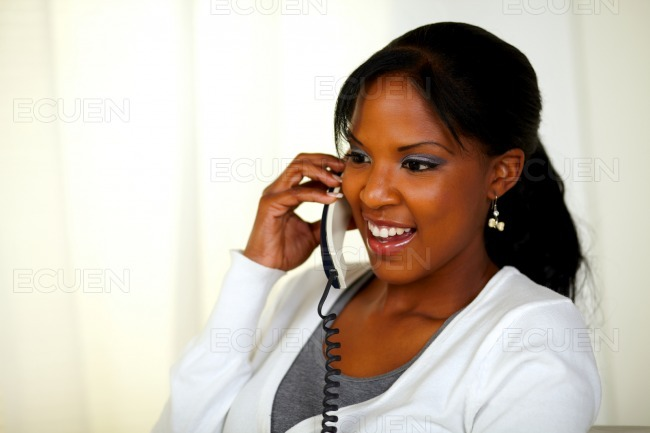 Charming relaxed female speaking on phone stock photo