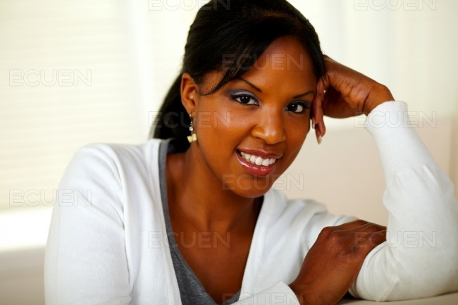 Charming relaxed woman smiling and looking at you stock photo