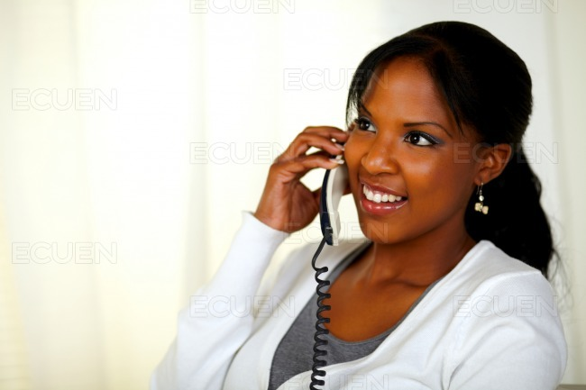 Charming relaxed woman speaking on phone stock photo
