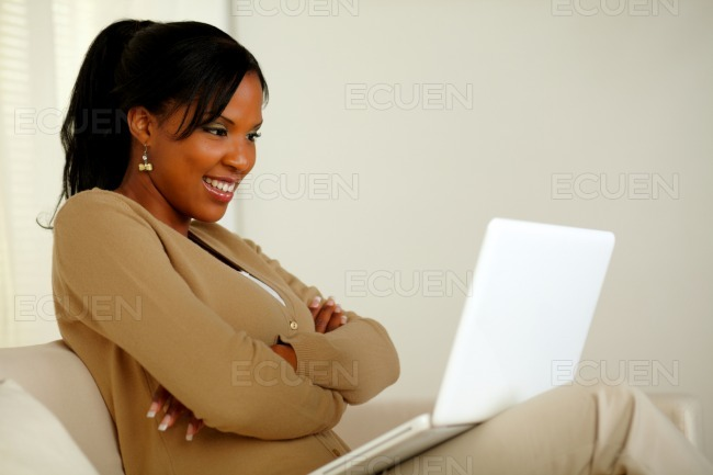Charming woman looking to laptop screen stock photo