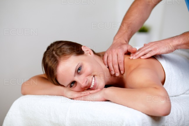 Charming young blonde woman relaxing at a spa stock photo