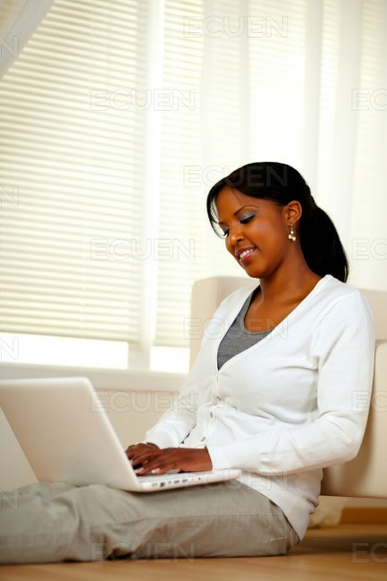 Charming young female working on laptop stock photo