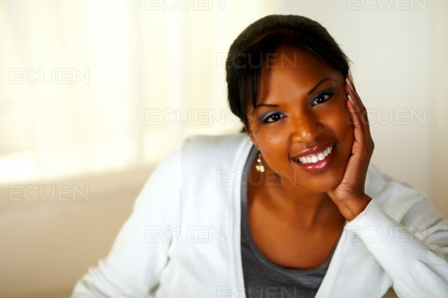 Charming young woman smiling and looking at you stock photo