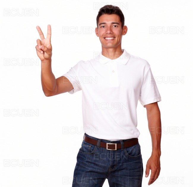 Cheerful adult with finger gesture is smiling.