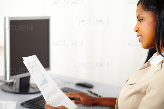 Cheerful executive looking documents stock photo