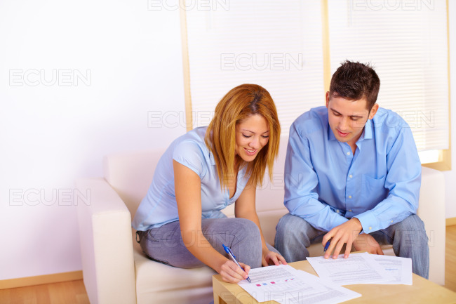 Couple reading documents stock photo