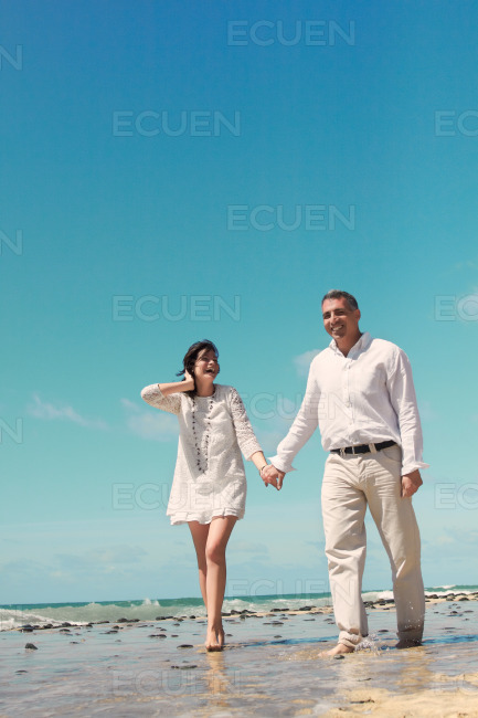 Couple walking and laughing stock photo