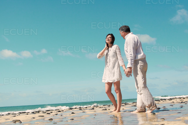 Couple walking, talking and laughing stock photo