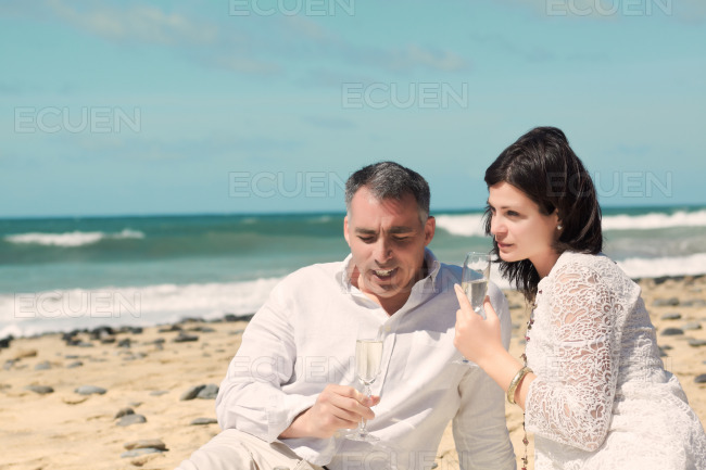 Couples talking with glasses in hand stock photo