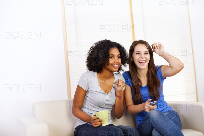 Cute girls watching TV stock photo