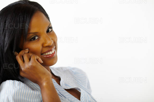 Cute young woman on mobile phone stock photo