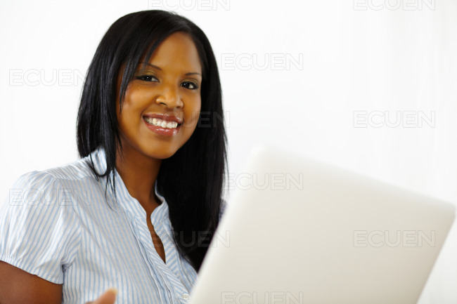 Cute young woman using a laptop stock photo