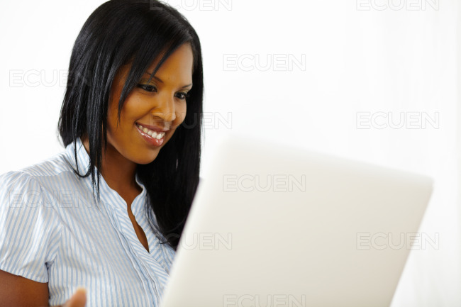Cute young woman working on laptop stock photo
