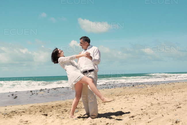 Dancing on the beach stock photo
