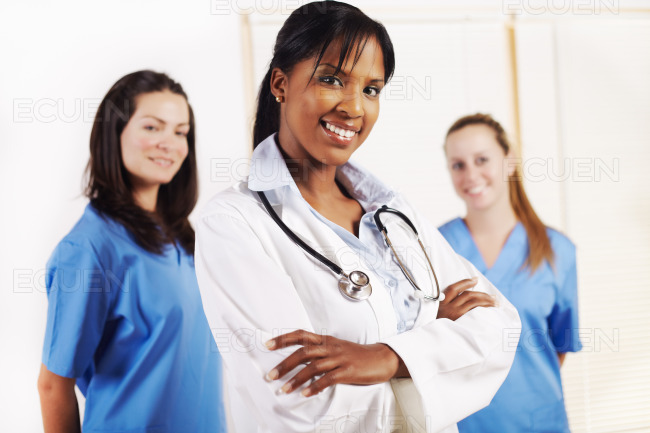 Doctor standing in front of his team stock photo