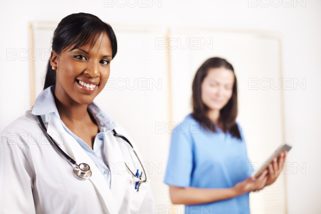 Doctor with one of his co-workers stock photo