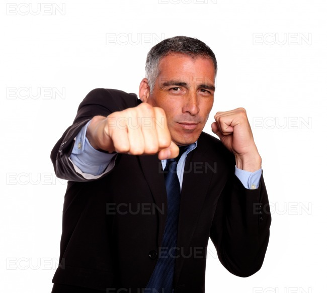 Elegant business man boxing stock photo